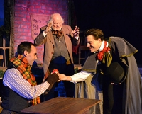 Nephew Fred gives Bob Cratchit a Christmas apple--