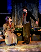 The lovely Belle and Young Scrooge as a young businessman.
