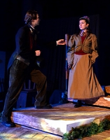 Young Scrooge begs Belle to stay----