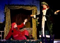 Christmas Present visits Scrooge...